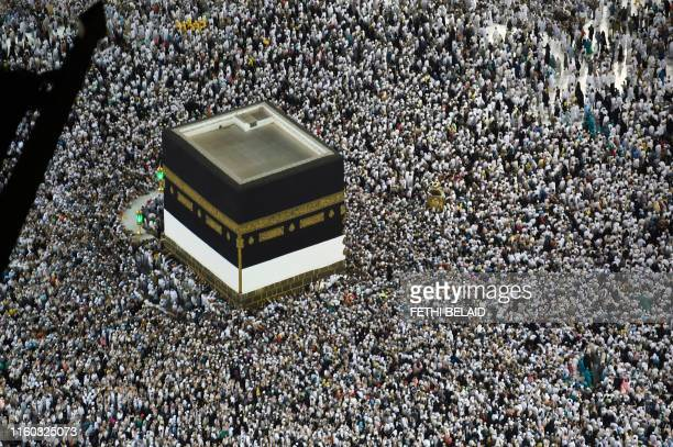 Muslim pilgrims gather around the Kaaba Islam's holiest shrine at the Grand Mosque in Saudi Arabia's holy city of Mecca on August 8 prior to the...
