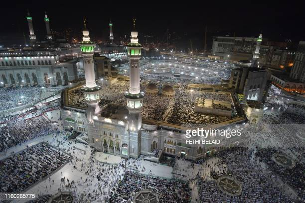 Muslim pilgrims gather at the Grand Mosque in Saudi Arabia's holy city of Mecca on August 7 prior to the start of the annual Hajj pilgrimage in the...