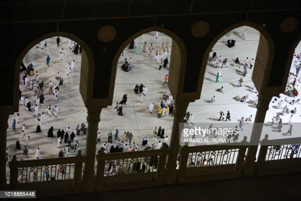 Muslim pilgrims gather for prayers at the Grand Mosque in Saudi Arabia's holy city of Mecca on August 18 ahead of the start of the annual Hajj...