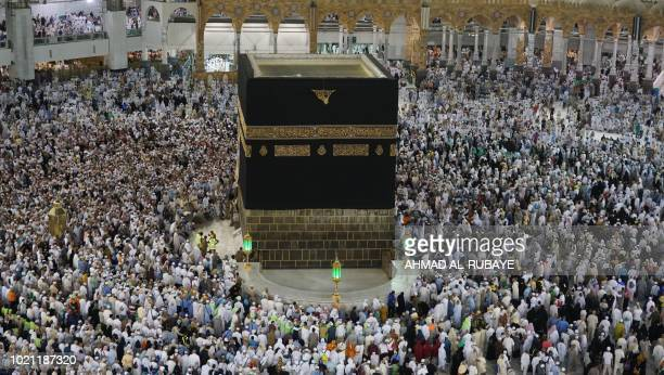 Muslim pilgrims gather for prayers at the Grand Mosque in Saudi Arabia's holy city of Mecca early on August 22 during the annual Hajj pilgrimage...