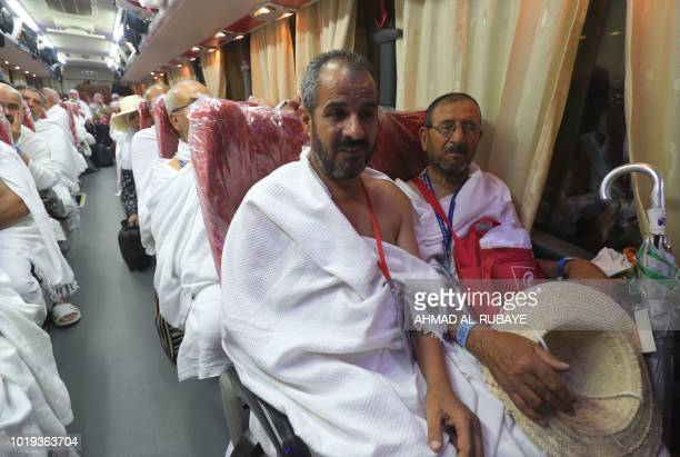 Muslim pilgrims gather in a bus in Saudi Arabia's holy city of Mecca set to the tentcity of Mina during the first day of the annual Hajj pilgrimage...