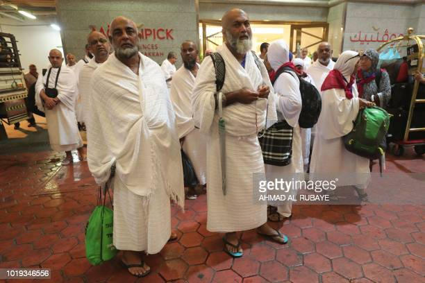 Muslim pilgrims gather in Saudi Arabia's holy city of Mecca before departing to Mina during the first day of the annual Hajj pilgrimage on August 19...