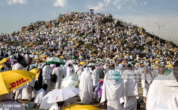 TOPSHOT Muslim pilgrims gather on Mount Arafat also known as Jabal alRahma southeast of the Saudi holy city of Mecca on Arafat Day which is the...