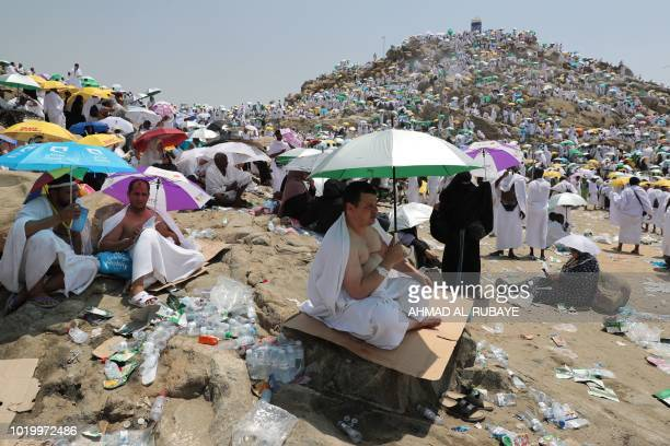 Muslim pilgrims gather on Mount Arafat also known as Jabal alRahma southeast of the Saudi holy city of Mecca for a day of prayers and repentance as...