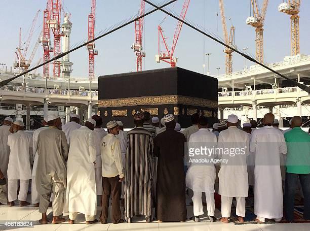 Muslim pilgrims gathering for the annual Hajj pilgrimage perform their prayer toward the Kaaba Islam's holiest shrine at Masjid alHaram in the Muslim...