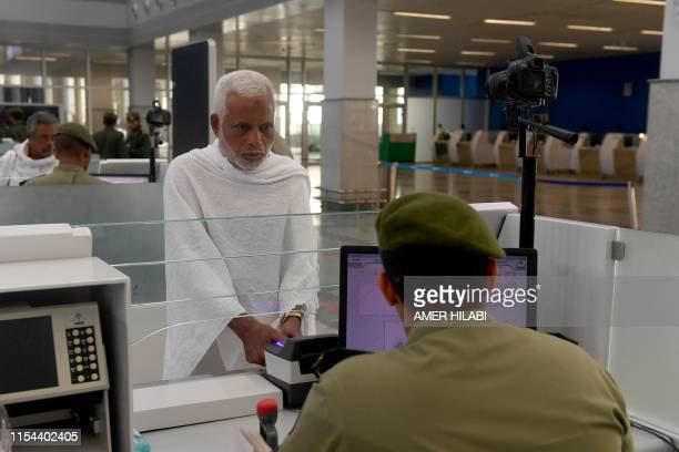 Muslim pilgrims go through passport control upon their arrival to King Abdulaziz International Airport in Jeddah on July 7 prior to the annual Hajj...