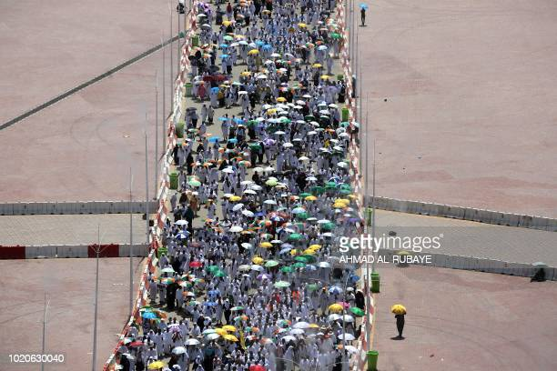 Muslim pilgrims head to take part in the symbolic stoning of the devil at the Jamarat Bridge in Mina near Mecca which marks the final major rite of...