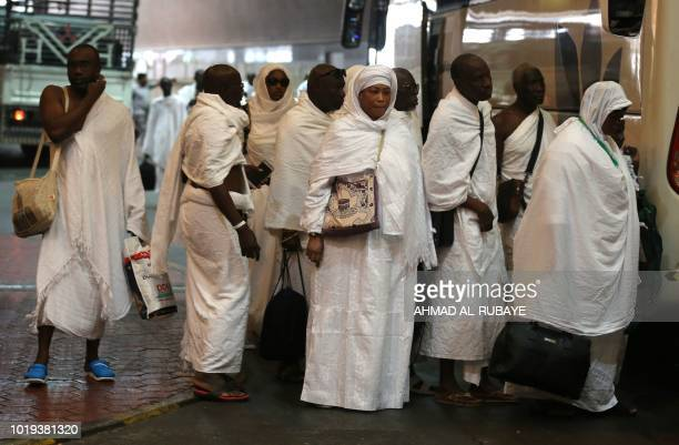 Muslim pilgrims line up to board a bus in Saudi Arabia's holy city of Mecca bound for the tentcity of Mina during the first day of the annual Hajj...