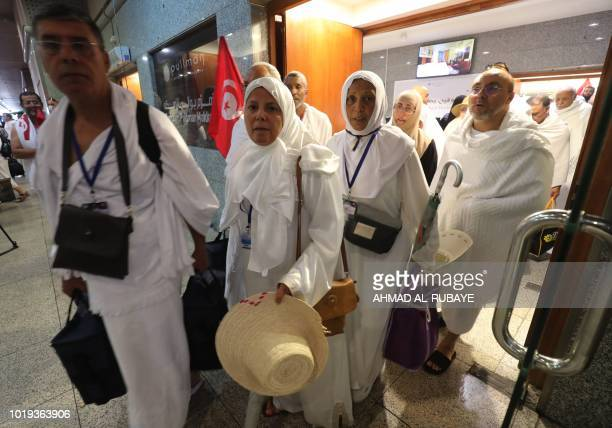 Muslim pilgrims line up to board buses in Saudi Arabia's holy city of Mecca bound for the tentcity of Mina during the first day of the annual Hajj...