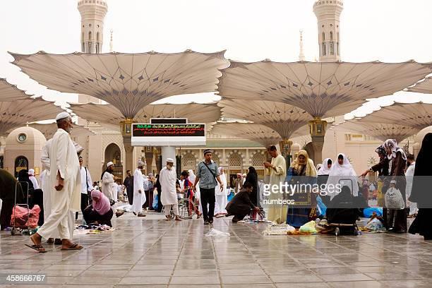 muslim pilgrims, medina, saudi arabia - al masjid al nabawi stock photos and pictures