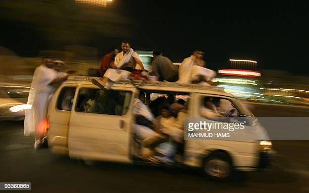 Muslim pilgrims move in a bus from Mecca to Mina on November 24 2009 Some 25 million Muslims from more than 160 countries converge annually on the...