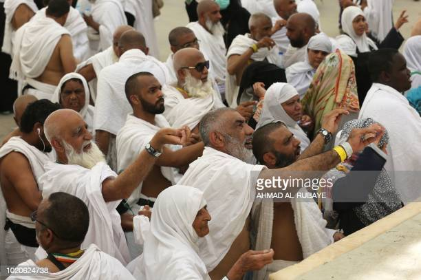 Muslim pilgrims partake in the symbolic stoning of the devil at the Jamarat Bridge in Mina near Mecca which marks the final major rite of the Hajj on...