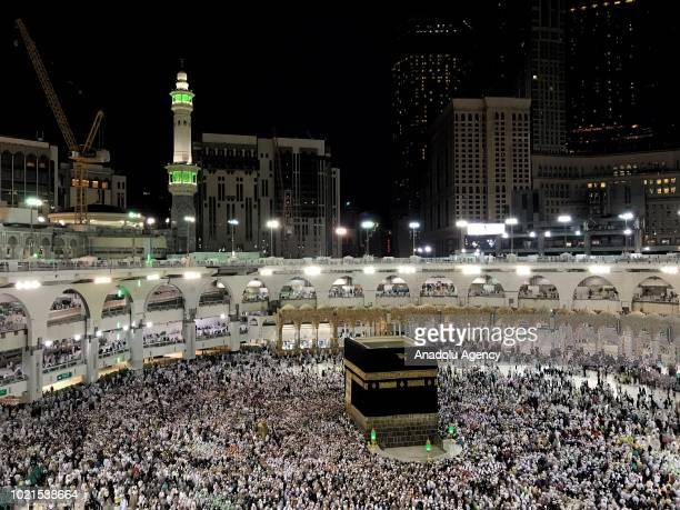 Muslim pilgrims perform farewell circumambulation in Kaaba, Mecca, Saudi Arabia to complete their hajj pilgrimage following the ritual of stoning the...