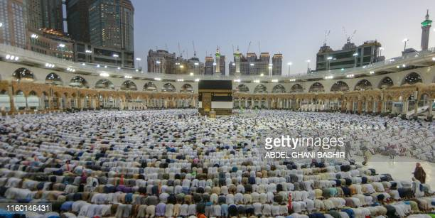 Muslim pilgrims perform prayers around the Kaaba, Islam's holiest shrine, at the Grand Mosque in Saudi Arabia's holy city of Mecca on August 7 prior...