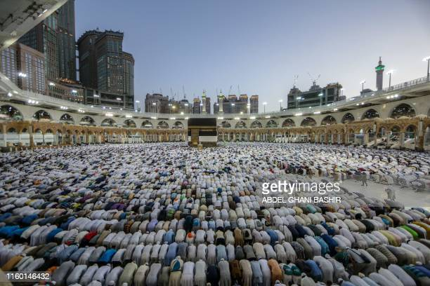 TOPSHOT Muslim pilgrims perform prayers around the Kaaba Islam's holiest shrine at the Grand Mosque in Saudi Arabia's holy city of Mecca on August 7...