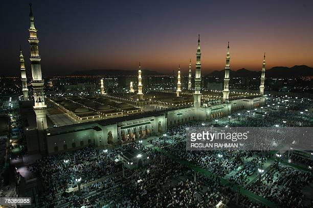 Muslim pilgrims perform the evening prayer at the Prophet Mohammed Mosque in the holy city of Medina in Saudi Arabia 11 December 2007 Eid alAdha the...