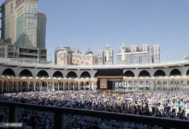 Muslim pilgrims perform the final walk around the Kaaba at the Grand Mosque in the Saudi holy city of Mecca on August 13 2019 Muslims from across the...