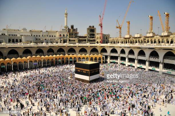 Muslim pilgrims perform the last Friday prayer around the Kaaba at Masjid alHaram ahead of the upcoming Eid alAdha on August 17 2018 in the holy city...