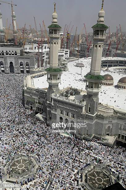 Muslim pilgrims perform the last Friday prayers around the Kaaba at Masjid alHaram ahead of the upcoming Eid alAdha on October 11 2013 in the holy...