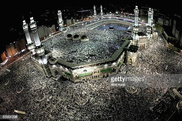 Muslim pilgrims pray around the holy Kaaba at Mecca's Grand Mosque during the annual hajj rituals on January 17 2005 in Mecca Saudi Arabia According...