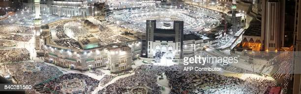 Muslim pilgrims pray around the Kaaba the cubic building at the Grand Mosque ahead of the annual Hajj pilgrimage in the Muslim holy city of Mecca...