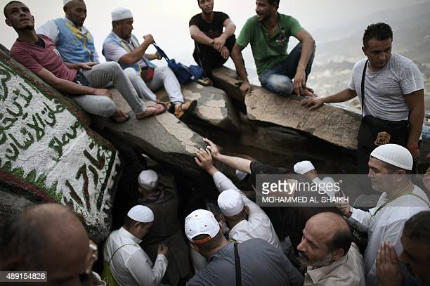 Muslim pilgrims pray as they visit the Hiraa cave on Noor mountain on September 19 2015 as more than a million Muslims from around the world converge...