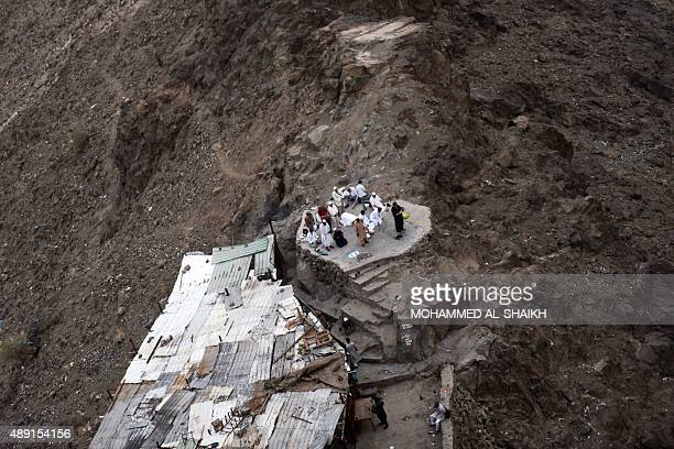 Muslim pilgrims pray as they visit the Noor mountain where the Hiraa cave is located on September 19 2015 as more than a million Muslims from around...