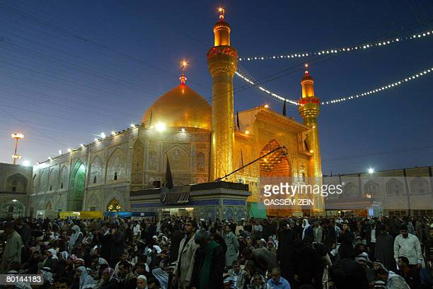 Muslim pilgrims pray at Imam Ali's Shrine in the Shiite holy city of Najaf in central Iraq on March 6 2008 Iraqi authorities deployed more than 35000...