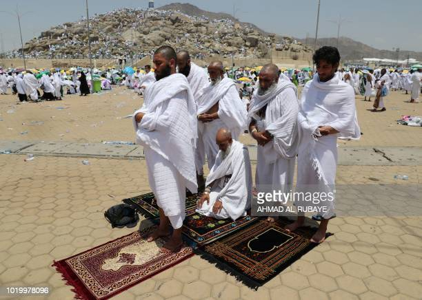 Muslim pilgrims pray at Mount Arafat also known as Jabal alRahma southeast of the Saudi holy city of Mecca as the climax of the Hajj pilgrimage...
