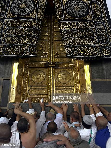 Muslim pilgrims pray at the door of the Kaaba Islam's holiest site located in the center of the Masjid alHaram ahead of the start of the annual Hajj...