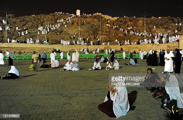 Muslim pilgrims pray at the foot of Mount Arafat southeast of the Saudi holy city of Mecca on November 4 2011 More than 25 million pilgrims gathered...