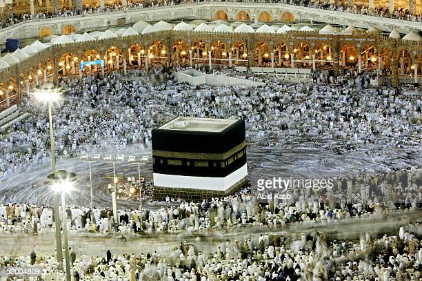 Muslim pilgrims pray at the holy Kaaba at Mecca's Grand Mosque during the annual hajj rituals January 17 2005 in Mecca Saudi Arabia Officials say...
