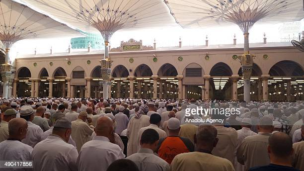 Muslim pilgrims pray at the Masjid alNabawi where the tomb of Prophet Mohammad is located in Medina Saudi Arabia on September 28 after they...