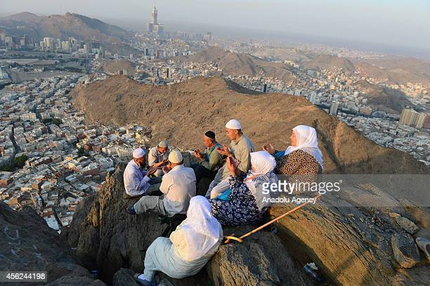 Muslim pilgrims pray at the top of al Nour mountain near Hira cave where Prophet Muhammad received the first revelation of the Quran on September 28...
