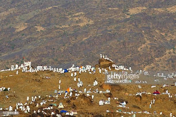 Muslim pilgrims pray in the Mina valley near the Saudi Arabian holy city of Mecca on November 14 as some 25 million Muslim pilgrims descend on the...