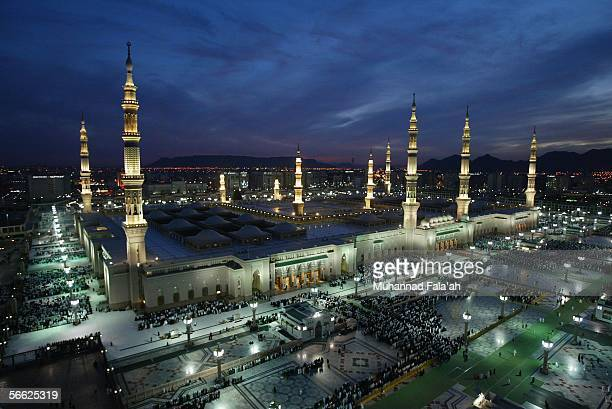 Muslim pilgrims pray near the Prophet Muhammad mosque on January 19 2006 in the holy city of Medina Saudi Arabia Saudi authorities are turning...
