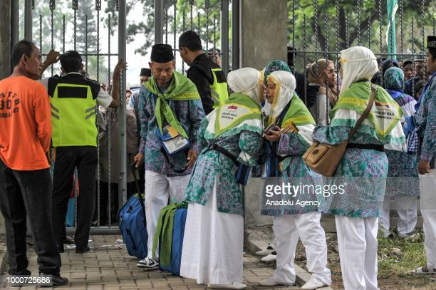 Muslim pilgrims prepare before departing to the holy city of Mecca at Hajj boarding house Pondok Gede in Jakarta Indonesia on July 17 2018