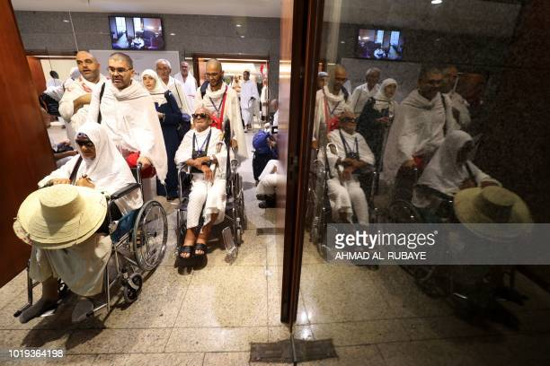 Muslim pilgrims prepare to board buses in Saudi Arabia's holy city of Mecca bound for the tentcity of Mina during the first day of the annual Hajj...