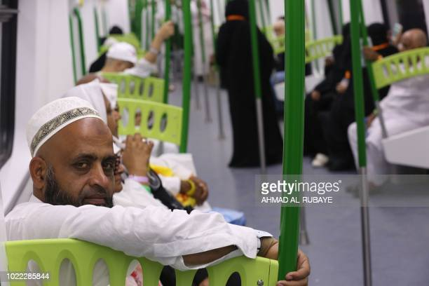 Muslim pilgrims ride on a metro from Arafat area to Mina during the annual Hajj season in the western Saudi city of Mecca on August 22 2018 The Holy...