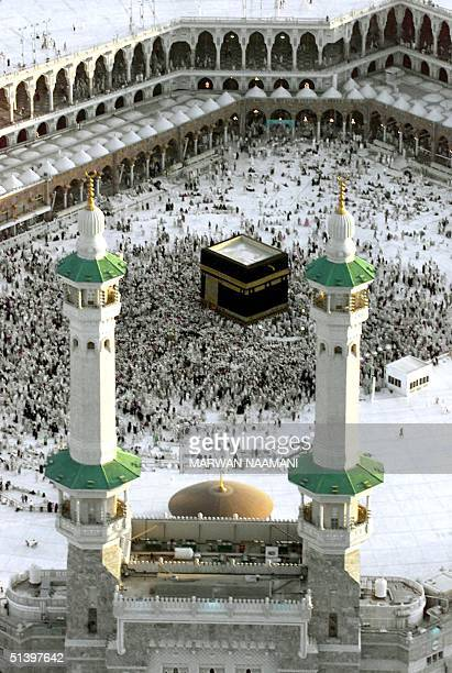 Muslim pilgrims rotate around the holy Kaaba in the holy city of Mecca in the second day of Eid alAdha 17 March 2000