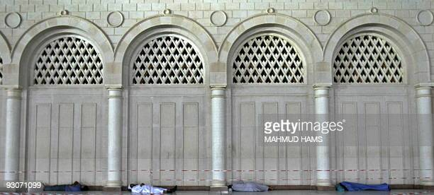 Muslim pilgrims sleep near Prophet Mohammed Mosque in the Saudi holy city of Medina on November 13 2009 More than three million Muslims are expected...
