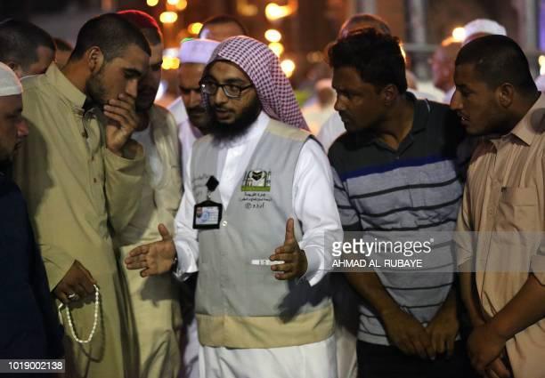 Muslim pilgrims speak to a translator in the Saudi holy city of Mecca ahead of the start of the Hajj pilgrimage on August 17 2018 The sixday Hajj...