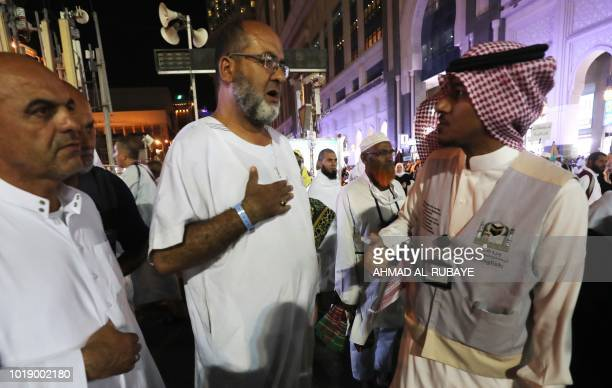 Muslim pilgrims speak to a translator in the Saudi holy city of Mecca ahead of the start of the Hajj pilgrimage on August 17 2018 The sixday hHajj...