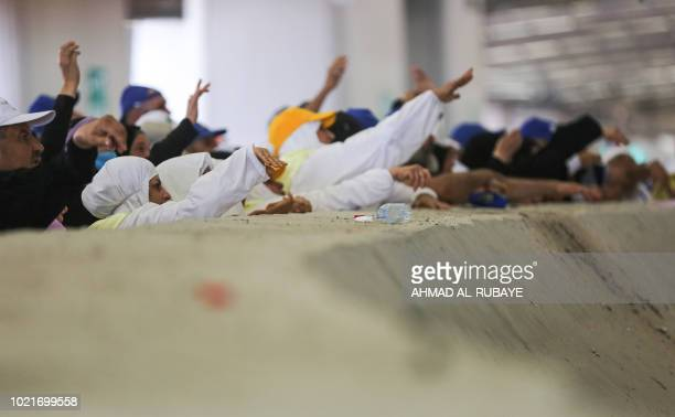 Muslim pilgrims take part in the symbolic stoning of the devil at the Jamarat Bridge in Mina near Mecca which marks the final major rite of the hajj...