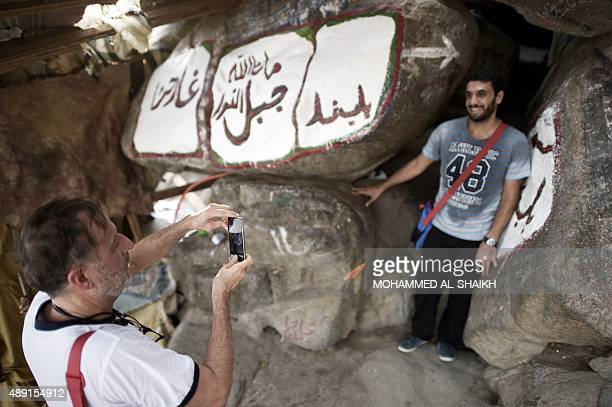 Muslim pilgrims take pictures as they visit the Hiraa cave on Noor mountain on September 19 2015 as more than a million Muslims from around the world...