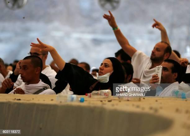Muslim pilgrims throw pebbles at pillars during the 'Jamarat' ritual the stoning of Satan in Mina near the holy city of Mecca on September 12 2016...