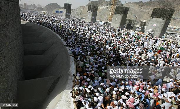 Muslim pilgrims throw stones at three pillars representing Satan on the second day of Eid alAdha in Mina near the holy city of Mecca 31 December 2006...