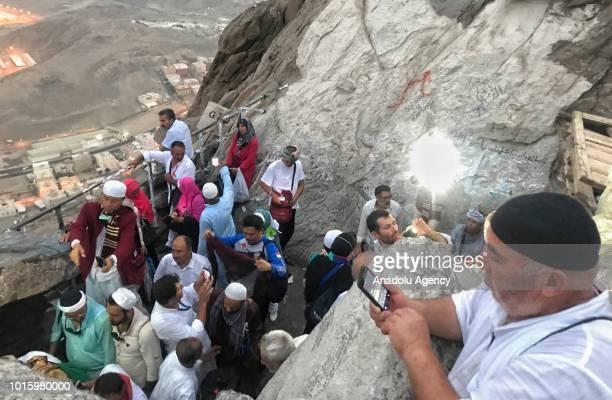 Muslim pilgrims visit the Jabal alNour and Hira Cave during the annual Hajj pilgrimage in Mecca Saudi Arabia on August 12 2018 Hira Cave where the...