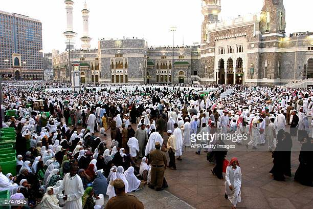 Muslim pilgrims wait outside Mecca's Grand Mosque Islam's holiest shrine to break their fasting 20 November 2003 on the 27th night of the holy...