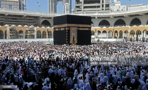 Muslim pilgrims walk around the Kaaba Islam's holiest shrine at the Grand Mosque in Saudi Arabia's holy city of Mecca on February 27 2020 Saudi...